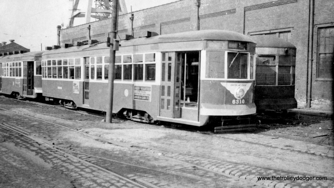 "CTA Sedan (aka ""Peter Witt"") 6310 appears to have been converted to one-man in this view circa 1952 view at South Shops. However, it may not have been used in service this way before being scrapped. (Roy W. Bruce Photo)"