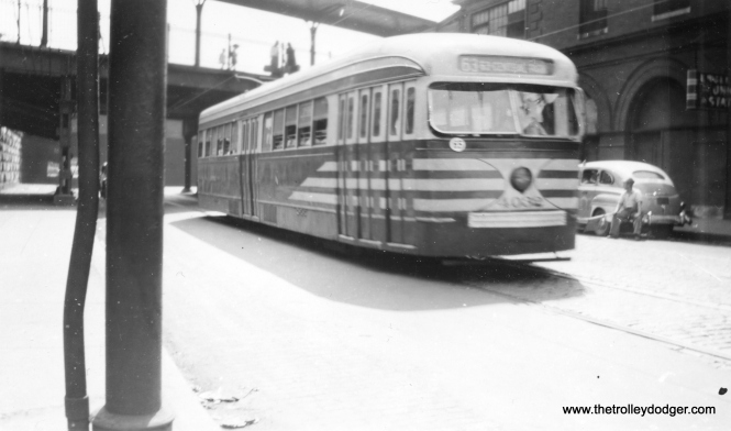 "This picture is a bit blurred due to motion, but it does show prewar CTA PCC in July 1948, heading west at Englewood Union Station, at that time an important train hub. M. E. writes: ""Actually, the westbound streetcar is in the process of passing the Englewood Union Station, which is the building on the right. Behind the streetcar is the platform for New York Central and Nickel Plate trains. Behind the photographer is the platform for Rock Island trains. To the right of the station is the platform for Pennsylvania Railroad trains."""