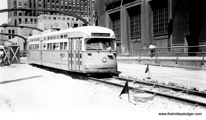 CTA 4101 heads east on Madison after having crossed the Chicago River during construction of Lower Wacker Drive. That's the former Chicago Daily News building at rear. The date is July 4, 1951.