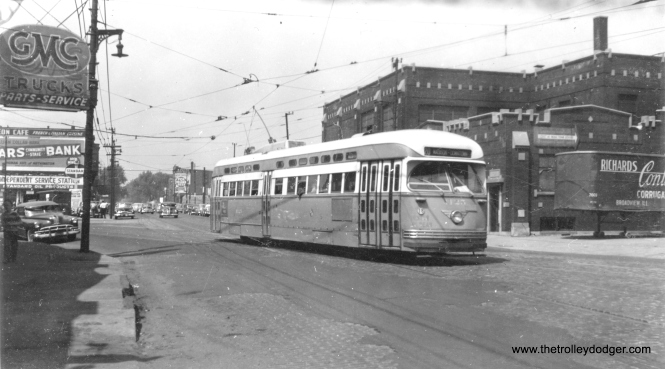 CTA 4125 is eastbound at Harrison and Fifth Avenue. We posted a different picture taken at this location here. This car was on the Madison-Fifth branch line on route 20. Oddly enough, streetcar service on the branch line lasted longer than the main line. The building behind the streetcar is the Kux Machine Company, located at 3924-44 W. Harrison St. We are facing west, and everything on the right side of the picture was cleared away in the early 1950s to build the Congress (Eisenhower) expressway. (Roy W. Bruce Photo)