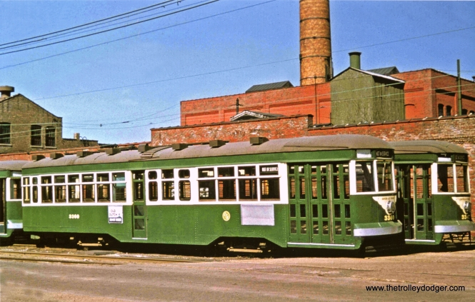 CTA Sedans (Peter Witts) 3360 and 3347 are shown here at south Shops in 1952, having been converted to one-man with the removal of some center doors. There were 25 cars so modified, but as far as I know, only one ran in service in this setup. (Robert W. Gibson Photo, John F. Bromley Collection)