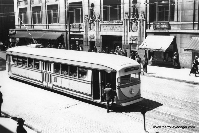 CSL 7001 on route 22 at Clark and Adams. The Banker's Building at rear, now known as the Clark-Adams building, is located at 105 W. Adams. 476 feet tall, it is the tallest building ever built in Chicago to be clad entirely in brick. It was built in 1927 and this photo was probably taken in the 1930s.