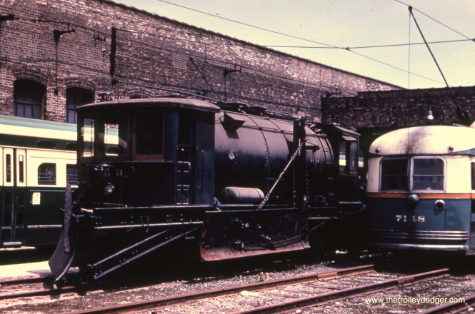 CTA 7148 is next to sprinkler/plow D3 at Devon Station on May 16, 1954. D3 was scrapped on December 14, 1956.