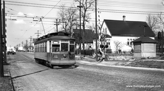 "This photo of CSL 2589 is at Michigan and 121st on the Riverdale line, crossing the Blue Island branch of the Illinois Central electric suburban service (today's Metra Electric). There is another picture of the same car in our post Chicago Streetcars in Black-and-White, Part 6 (May 11, 2015), which explains why 2589 has ""keep to right"" scrawled on it. That was to warn drivers not to try passing the car on the left while on the bridge over the Little Calumet River, where the line was single track. 2589 was a so-called ""Robertson"" car, built by St. Louis Car Company in 1901. (Joe L. Diaz Photo)"