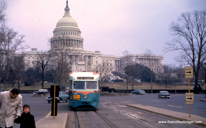 "DC Transit 1101 in front of the Capitol Building on January 21, 1962, shortly before the end of streetcar service, for 54 years, anyway. Sderailway adds: ""car 1101 (St. Louis Car 1937) heads west on Pennsylvania Ave. NW from the Navy Yard at 8th and M sts SE. The car has just passed the Peace Monument seen between the back of the car and the US Capitol Building."""