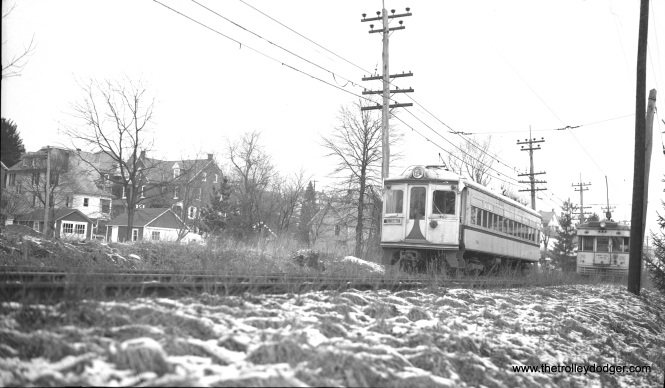 LVT 702 passes one of the ex-C&LE lightweights in the 1000-series at Seller's Siding on February 11, 1951.