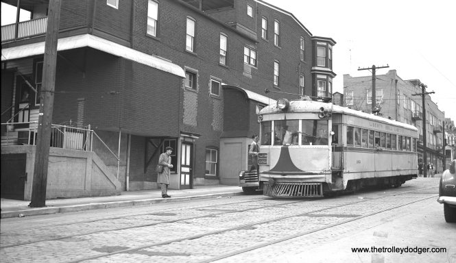 LVT 1002 picks up some passengers on Washington Street on April 1, 1951. Note the dent on the front of the car.