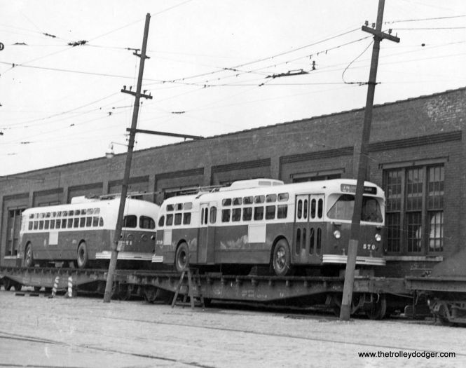 CTA trolley buses 570 and 571 being delivered on Illinois Central flatcars.