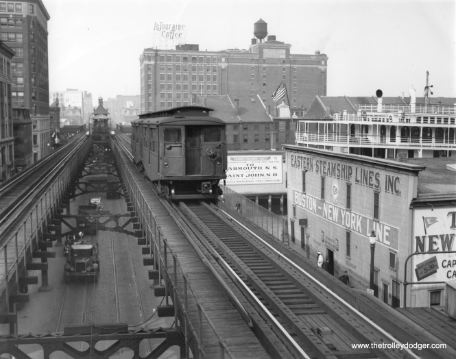 A Boston Elevated Railway train of 0300-class cars , near Rowes Wharf station on the last day of the Atlantic Avenue el, September 28, 1938. (Robert Stanley Collection)