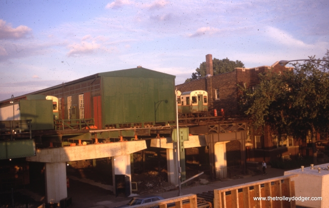 "There was only a brief period when this May 1969 photo could have been taken. What we see is the west end of the Englewood ""L"" yard near Loomis. The yard itself was renovated in the early 1960s, as evidenced by the concrete supports. We are standing on a newly built section of ""L"", soon to be connected to the rest of the structure, that extended this line to Ashland, a more practical terminus that provides a better place for bus transfers. We are looking east."