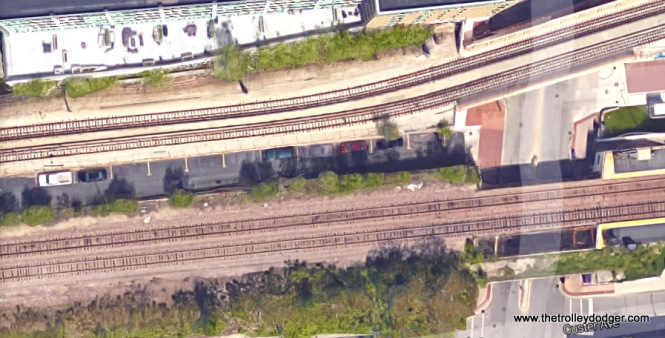 An aerial view, showing where the picture of 5003 was taken near Main and Chicago. There is a gap between the CTA Evanston branch and the Metra UP-North Line (formerly, the Chicago & North Western), large enough for a short paved road, now mainly used for parking.