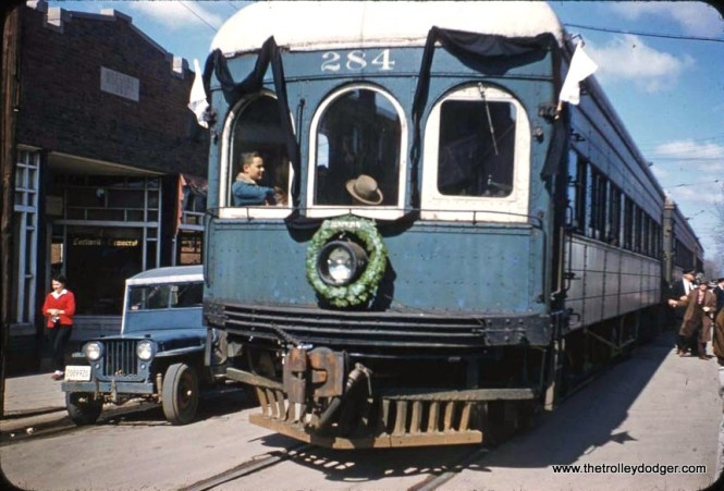 The last run of the Illinois Terminal interurban, shown here in Carlinville, took place on March 3, 1956. Older equipment like car 284 was used instead of the railroad's relatively new streamliners. The black bunting draped on this car is now at the Illinois Railway Museum.