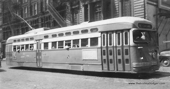 "It's hard to make out the location of this Pullman-built postwar PCC. One of our readers writes: ""I believe that this photo was taken on Dearborn Street just north of Adams. The building in the background on the far left looks like the Marquette Building. The front destination sign reads 42 and the side sign reads Halsted-Archer-Clark."""