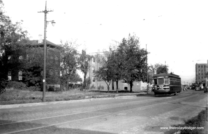 CSL 3327 is southbound, most likely on route 22 Clark-Wentworth, in this 1930s scene. It's possible this may be north Clark Street just south of Birchwood, where there is a curve. That is just a few blocks south of Howard, which was the end of the line. There is a building at Clark and Howard that resembles the one at right. (Edward Frank, Jr. Photo)