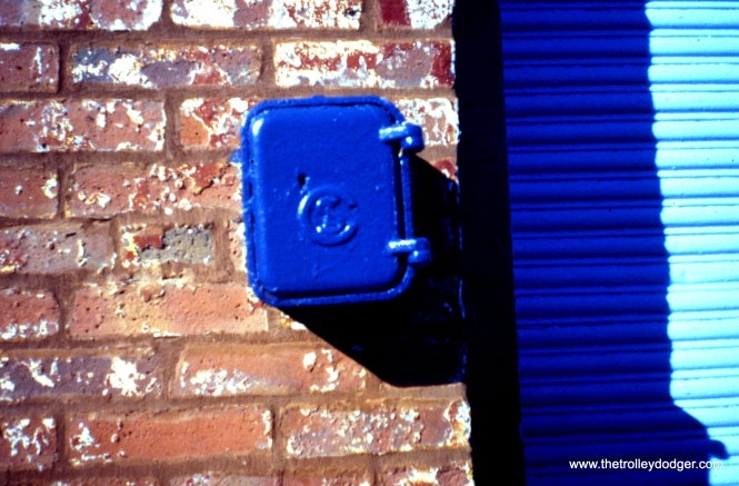 This CSL call box is still standing on the south side of the east end of the building located at 6238 S. Wabash Avenue, now (2003) home to the Jitney Taxicab Association. The building was originally constructed as a wreck wagon barn for the Chicago City Railway Company. View looks west. (William Shapotkin Photo)
