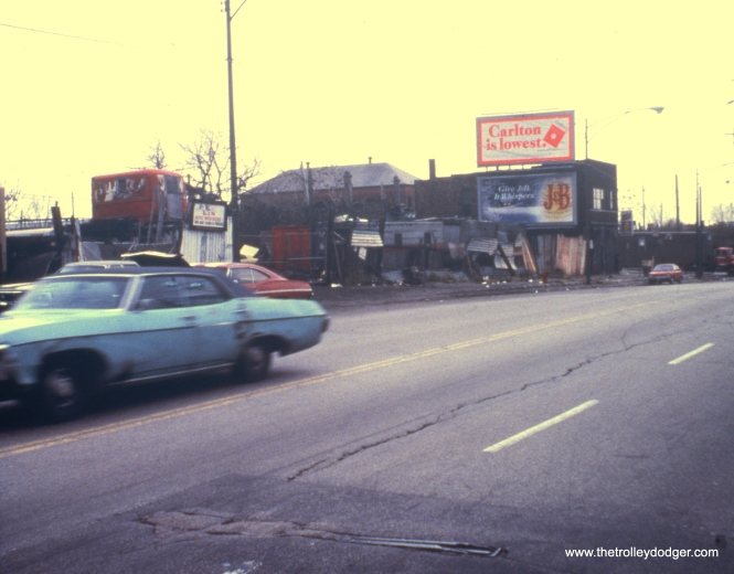 Showing through the pavement in this 1970s view is a switch stand odd southbound State Street leading to the one-time 62nd Street streetcar loop. View looks south on State Street. (David S. Stanley Photo)