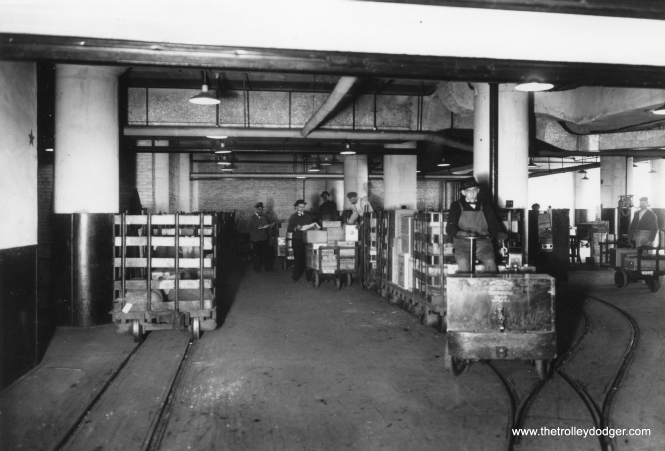 Loading and unloading freight in the Murdock Company sub-basement.