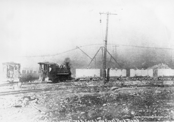 A Chicago Tunnel Company steam locomotive and cars at the lakefront, creating landfill.