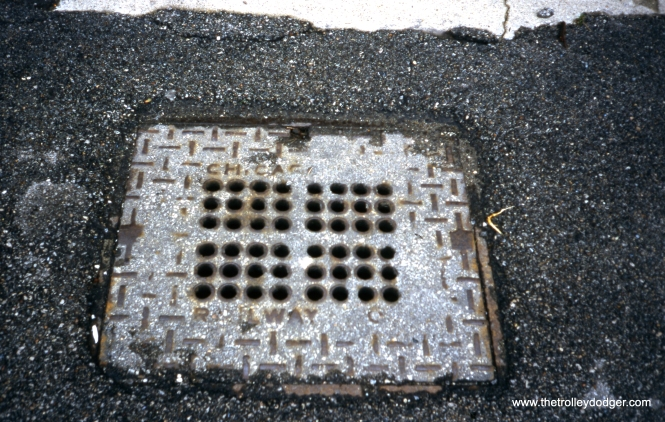 This century-old manhole cover, in the same general area as the previous pictire, still reads Chicago City Railway Company. (William Shapotkin Photo)