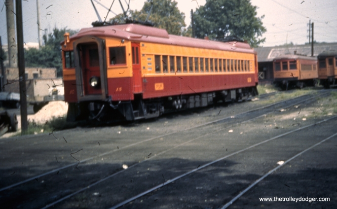 Here is a rare color shot of Chicago, South Shore & South Bend car 15, after it had been modernized in 1942. According to CERA Bulletin 41, the car had a red roof, but it looks more purple in this picture. I think the photo shows the accurate color, since a red roof would not have provided contrast with the maroon car body. I'm not sure what date the car was repainted to the much more familiar South Shore Line traction orange, but it may have been shortly after World War II. The car was originally built by Pullman in 1926.