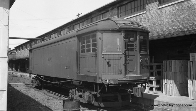 "According to Don's Rail Photos, Chicago North Shore & Milwaukee 213 ""was built by Cincinnati in March 1920, #2445, as a merchandise dispatch car. In 1940 it was rebuilt as a disc harrow ice cutter. It was retired in 1955 and sold to CHF as their 242. It was donated to Illinois Railway Museum in 1964."" This photo by the late Bob Selle shows it newly delivered to the Chicago Hardware Foundry in North Chicago on August 7, 1955."