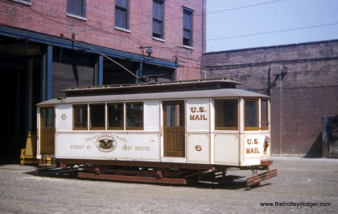 Former Chicago Surface Lines mail car 6, built in 1891, as it looked on May 25, 1958. This car is now at the Fox River Trolley Museum, where it was recently vandalized. You can see a black-and-white photo of this car, taken at the same time as this one, in our previous post Throwback Thursday (January 7, 2016). To see a picture of West Chicago Street Railway car 4, also taken the same day, there's one in our post Chicago Streetcars In Color (February 22, 2015).