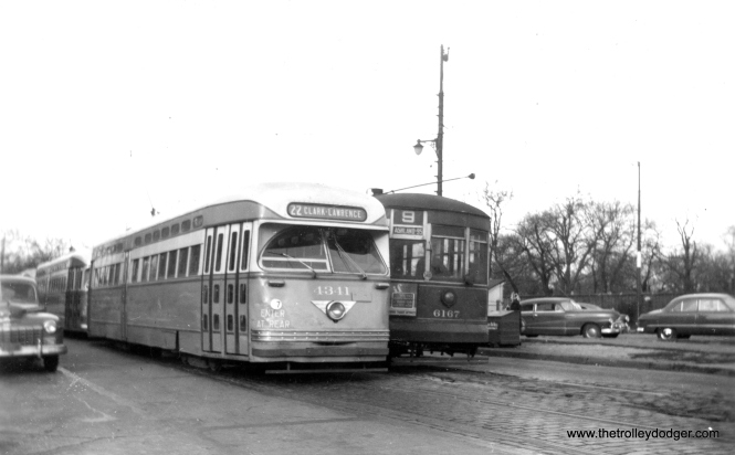 "It's November 14, 1948, and CTA PCC 4341 and its follower are on Southport at Clark Street, the north end of the #9 Ashland route-- a very unusual place for PCCs to be. That's Graceland cemetery on the east side of Clark. Andre Kristopans writes, ""The Clark PCC's parked on Southport are Cubs extras. Would have come down from Devon (note CLARK-LAWRENCE sign), and would be put away on normally-unused track on Southport. When game would let out, they would be backed back out onto Clark, and sent south."" Which all sounds very plausible except for the date of the photograph. But as Andre pointed out in a later note, on November 14, 1948 the Chicago Bears played the Green Bay Packers, and that game took place in Wrigley Field. So these PCCs are being held back until the end of the game. The Bears won that day, 7-6."