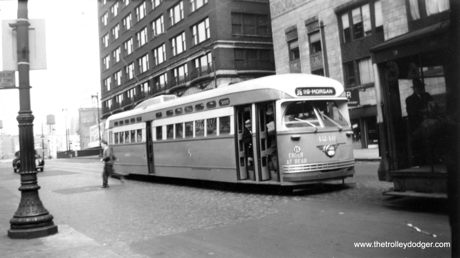 "Someone's just gotten off CTA PCC 4246 via the middle door on October 8, 1948. The car is heading southbound on route 36 - Broadway-State and is just north of Lake Street in this Mervin E. Borgnis photo. Borgnis wrote a number of different railfan books, and at one time worked as a motorman for the Lehigh Valley Transit Company in Allentown, Pennsylvania. Jim Huffman writes: ""It does not look like State St, to me it looks like Wabash. The Broadway-State route used Wabash as a detour until the State St bridge was constructed. The new bridge was Dedicated on 5/28/1949, which precludes it being on State."""