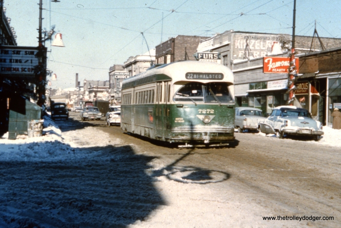 "It's winter, and CTA 7272 heads south. The local movie theater is showing The King and I, a musical starring Yul Brynner that was first released in June 1956. This picture probably dates to the winter of 1956-57, and there is a 1957 Plymouth visible at rear. One of our readers notes: ""The movie theater was the CALO THEATER at Clark and Balmoral. It is now occupied by a thrift store called The Brown Elephant. Photo was probably taken in December 1956 because of the Christmas decorations hanging on the line poles. Car is heading south on Clark."" You can read more about the Calo Theater here."