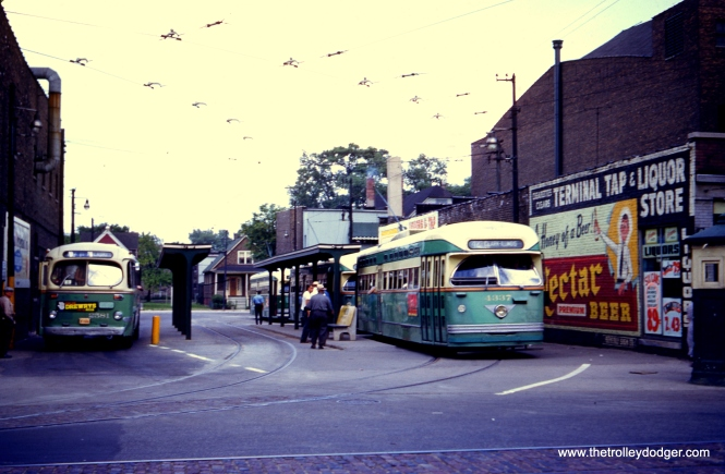 "On June 19, 1953, CTA Pullman-built PCC 4337 is at the Halsted and 79th loop, south end of route 8. But the car is signed for route 42, Halsted-Downtown, which was a variant on the line. CTA bus 2581 is at left. Soon, the Pullmans would begin disappearing from this route as they were sent off to St. Louis Car Company for scrapping in the ""PCC Conversion Program."" There are very few photos of PCCs on route 42, making this one a rarity."