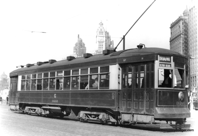 "CSL 3201 is northbound at State on the Broadway route. That's Tribune Tower and the Wrigley Building at rear. (Edward Frank, Jr. Photo) George Trapp: ""CSL 3201 is on State not Wabash sometime between 7/10/32 and 8/19/37. Car is one of two experimental MU cars built by CSL in 1924 with the 23 class cars. Cars ran mainly on Broadway after their first year."" Broadway-State cars ran on Wabash from 1939 to 1949, when the State Street bridge was being rebuilt."