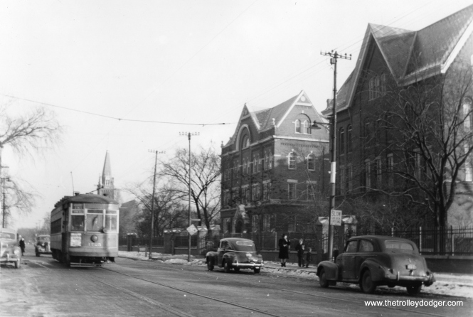"CSL 1725 on the Broadway-State route. Perhaps the buildings at left can help identify the location. (Edward Frank, Jr. Photo) Rex Nelson identifies this as Devon just west of Ridge. (Edward Frank, Jr. Photo) George Trapp: ""CSL 1725 is westbound on Devon at Damen, Angel Guardian Orphanage is located on South Side of Devon. Old St. Henry's Church is in background at Ridge Blvd."""