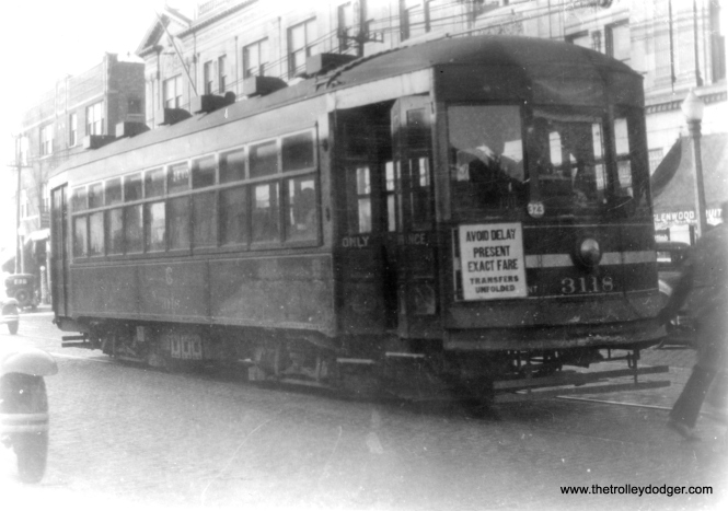 "CSL 3118, signed for Devon, in the mid-1930s. George Trapp: ""Cars 3111 and 3118 are westbound and eastbound respectfully at Devon and Glenwood (1400 west ) sometime prior to July 10, 1932 when the Devon shuttle was replaced by the extension of the Broadway and Through Route 1 cars to Devon-Kedzie. Both are 45 class small safety cars."""