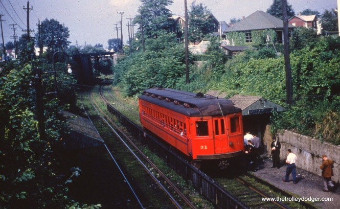 "Here is Lackawana & Wyoming Valley 31 as it appeared on August 3, 1952. Passenger service ended on this third-rail line at the end of that year. Some have wondered if the LL rolling stock could have benefited the Chicago, Aurora & Elgin, but the general consensus is these cars would have been too long to navigate the tight curves on the Loop ""L"", although perhaps they could have been used west of Forest Park. As it was, there were no takers and all were scrapped. Ironically, some thought was later given by a museum of adapting a CA&E curved-side car into an ersatz Laurel Line replica, but this idea was dropped."