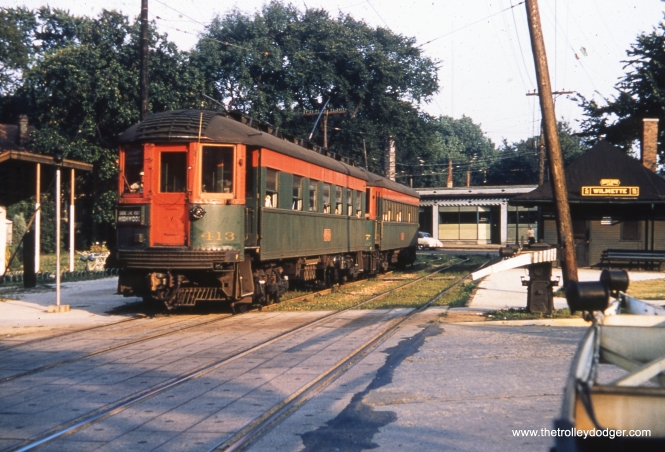 A northbound CNS&M Shore Line Route train, headed up by 413, at the downtown Wilmette station in June 1954. The Shore Line was abandoned not much more than one year later. We are looking to the southeast.