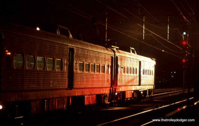 A train of Arrow MUs about to depart into the night.