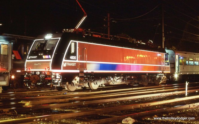 Brand new NJT ALP-46 # 4605 under the yard lights at Gladstone. This was the first time I saw one of these locomotives. I was very happy to find it in the yard that night and I think the photo came out quite well. Usually when a locomotive has had a lot of reflective tape applied to it's side, it is very difficult to photograph at night. This was not the case here, I actually shined a flashlight along the 4605 to light up the tape. 10/12/02