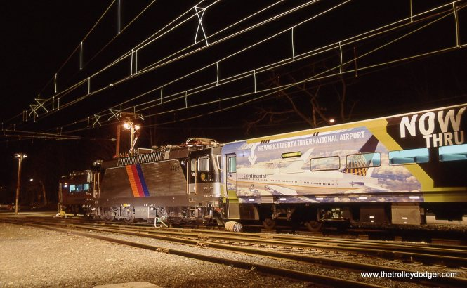 ALP-44 # 4404 with a coach wrapped with an advertisement for Continental Airlines.