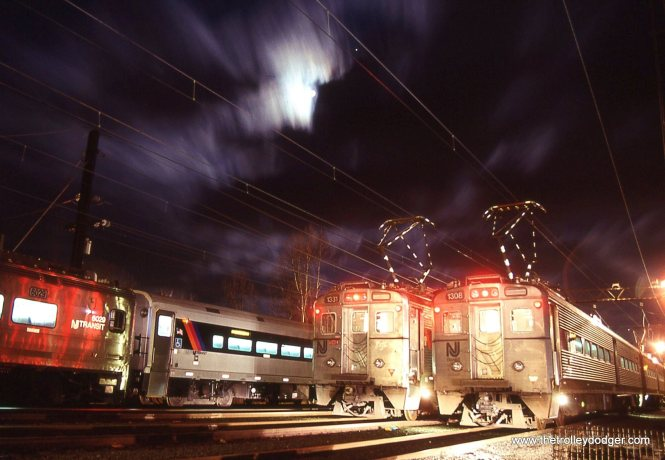 All the trial and error (mostly error) that goes into night film photography becomes worth every lousy slide tossed in the trash when you get just one that turns out like this! NJ Transit Arrow MU cars # 1331 and 1308 pose under a spectacular sky at Gladstone.