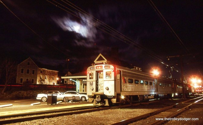 NJT MU # 1512 under a cloud cloaked full moon.