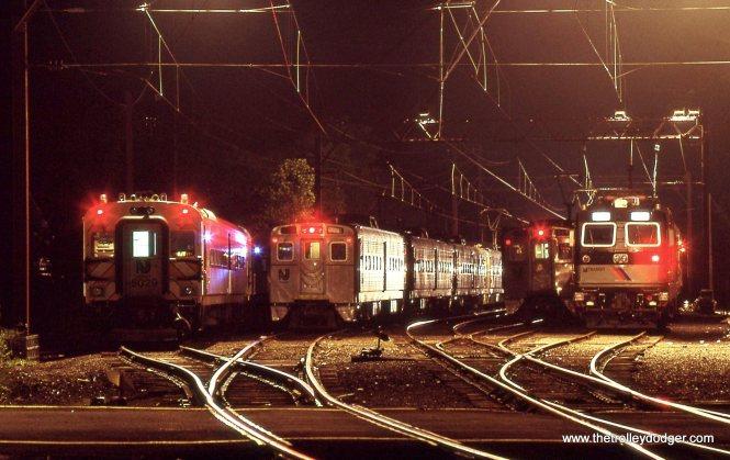 NJT yard line-up showing Comet coaches, Arrow MUs and a ALP-44 locomotive.