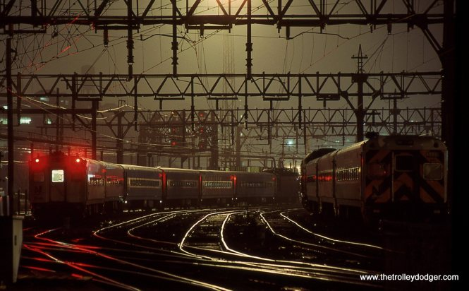 This was shot from the end of the passenger platforms looking west. A train with an ALP-44 is sitting in the yard 3/30/02