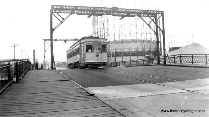 "This is a higher-res version of a photo that originally appeared in our post The ""Other"" Penn Central (May 29, 2016). Bob Lalich writes, ""The location of photo csl127 is East Chicago, IN. The road is Indianapolis Blvd and the bridge spans the west leg of the Indiana Harbor Canal. The car is SB."""
