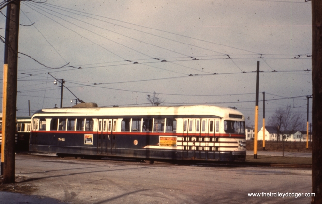 "CTA 7012 at the Narragansett Loop on the west end of route 63. Tony Waller adds, ""In image 257, the pre-war PCC must have been photographed in December 1951. All pre-war PCCs were removed from 63rd St. in Spring 1952 and rebuilt for one man operations (with elimination of one of the center doors). They were then assigned to Cottage Grove."""