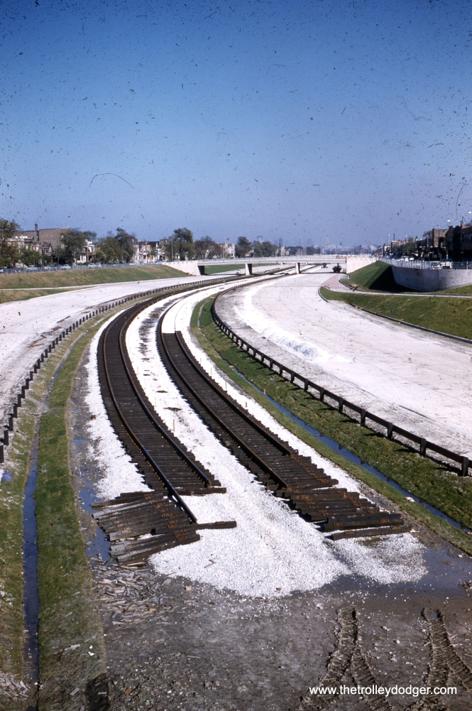 """Congress St. expressway under construction with rapid transit tracks in center strip, October 8, 1955."" The Garfield Park ""L"" tracks, whether temporary or existing, are not visible in this picture. The first tracks in the median line were laid on July 28, 1955 at Pulaski Road, with Mayor Richard J. Daley driving the first spike. Matt Cajda adds, ""In the Congress Expressway photo, the elevated Garfield Park tracks look visible to me just above the two bridges over the expressway. This would indicate that the photo could possibly be taken from the Homan Ave. or Kedzie Ave. bridge."" Andre Kristopans: ""The Congress construction is looking east at Kostner. Remember, Kostner station came later."" (Yes, the short-lived Kostner station, built on a curve, opened in 1962 as the result of lobbying by three local aldermen whose wards were nearby. It closed in 1973.)"