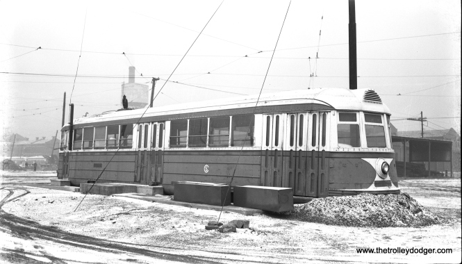 The experimental pre-PCC car 4001 ended its days on CTA property as a storage shed. It is shown here at South Shops on December 18, 1955. The body shell of 4001 is now preserved at the Illinois Railway Museum. (Bob Selle Photo)
