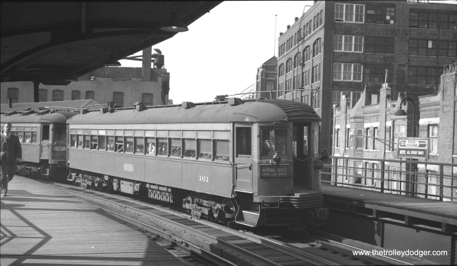 "It's the evening rush hour on June 3rd, 1959, and North Shore Line car 161 is on the tail end of a northbound train at Chicago Avenue on the ""L"". (Bob Selle Photo)"