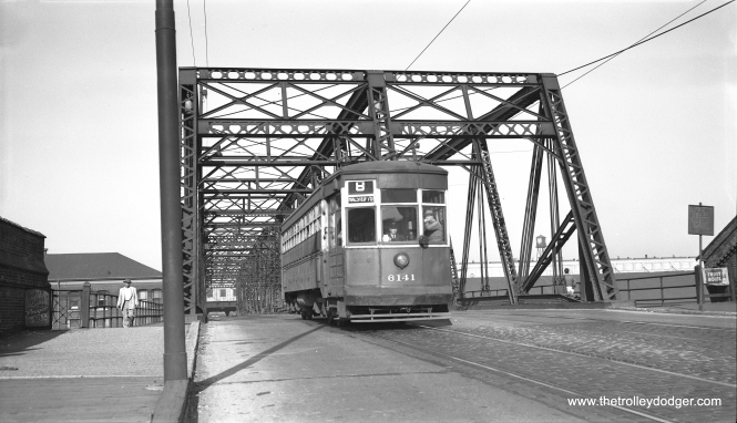 "CTA two-man arch roof 6141 coing off the south end of the Halsted Street bridge over the Milwaukee Road on November 16, 1953. This car was known as one of the ""Odd 17"" (actually 19), probably because it did not fit into some other series. Don's Rail Photos says, ""6141 was built by American Car Co in February 1918, #1079."" (Bob Selle Photo)"