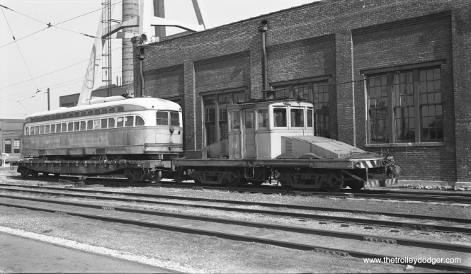 There are a lot of pictures like this, showing CTA PCC 7142 and locomotive L-201 at South Shops on May 25, 1958. This was the occasion of one of the final fantrips on Chicago's last remaining streetcar line, organized by the Central Electric Railfans' Association, which was abandoned less than one month later. 7142 was on its way down to the St. Louis Car Company for scrapping so that parts could be reused in Chicago rapid transit cars. (Bob Selle Photo)