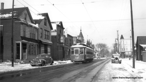 "CSL 2779 in a wintry scene, probably in the 1940s. The location is unknown, as the roll sign on the car simply reads ""Downtown."" According to Don's Rail Photos, this car was part of a series known as Robertson Rebuilds, built by St. Louis Car Company in 1903. Don Ross: ""These cars were similar to 2501-2625 but were longer and heavier. They were built with McGuire 10-A trucks but were replaced with Brill 51-E-1 trucks in 1918. An additional 20 cars were ordered, 2781-2800, but they were delivered to St Louis & Suburban Ry as 600-619. It replaced most of their cars in a carbarn fire that destroyed most of their equipment."" (Joe L. Diaz Photo) Michael Franklin: ""Headed south on Damen Ave with Roscoe St. in the distance."""